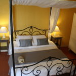 One of the larger guestrooms at La Belle Demeure Bed and Breakfast. A large 'Confort' bedroom, 22m² in size, bed 160 by 200 cm. In the heart of the Périgord Noir, Dordogne near to Sarlat. Pleasantly furnished en-suite guestrooms with comfortable beds, covered with 100% cotton Seersucker linen. Bedrooms. Table d'hôtes Evening Meal and Swimming Pool. For our nightly tariff, please look at our website.
